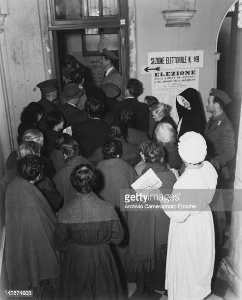 Voters queuing at a polling station in Italy during the general election 18th April 1948