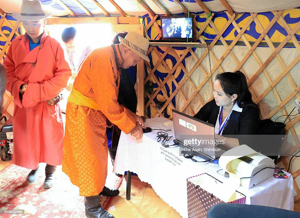 Voters register prior to casting ballots at a polling station on June 29, 2016 in Ulan Bator, Mongolia.