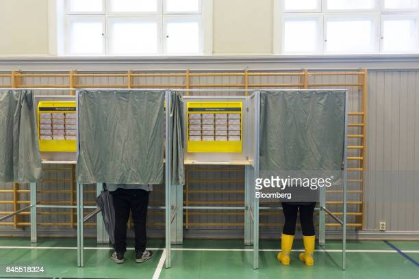 Voters register their votes in voting booths at a school polling station on the final day of the parliamentary vote in Oslo Norway on Monday Sept 11...