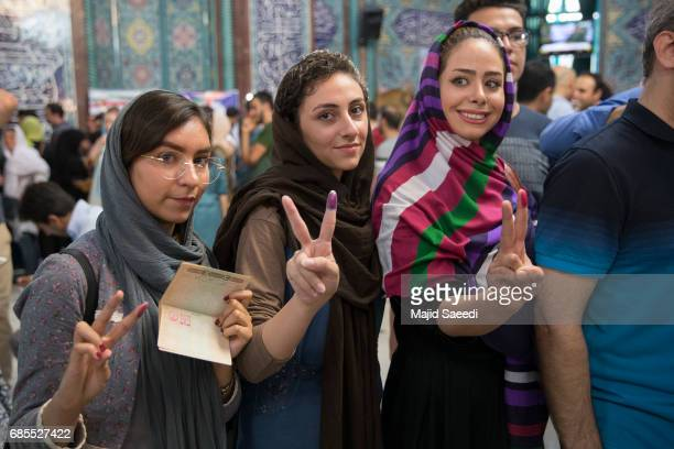 Voters show their inkstained fingers outside a polling station for the presidential election on May 19 2017 in Tehran Iran Millions of Iranians voted...