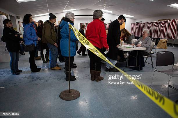 Voters sign up to cast their ballot at First Baptist Church on primary day February 9 in Nashua New Hampshire Tuesday is the 100th anniversary of the...
