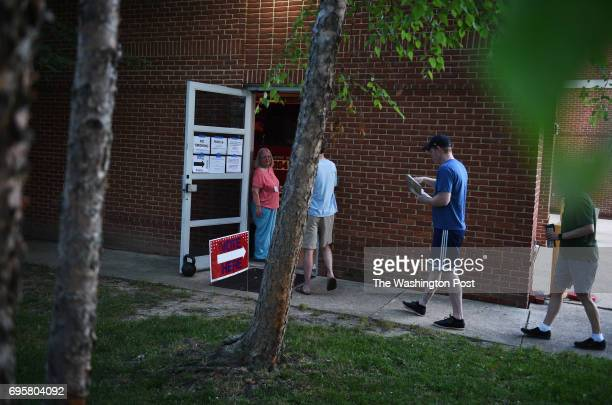 Voters stand in line at the Fire Department Headquarters in Alexandria VA June 13 early Tuesday morning to vote during the Virginia primaries Tom...