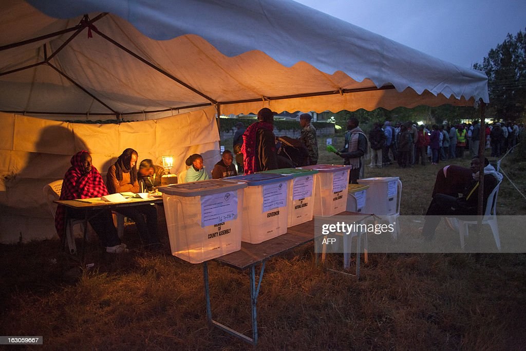 Voters stand in line to vote at Manyatta Primary School polling station in west Nairobi at dawn on March 4, 2013 during the elections. Long lines of Kenyans queued from far before dawn to vote Monday in the first election since the violence-racked polls five years ago, with a deadly police ambush hours before polling started marring the key ballot. The tense elections are seen as a crucial test for Kenya, with leaders vowing to avoid a repeat of the bloody 2007-8 post-poll violence in which over 1,100 people were killed, with observers repeatedly warning of the risk of renewed conflict. AFP PHOTO / GEORGINA GOODWIN