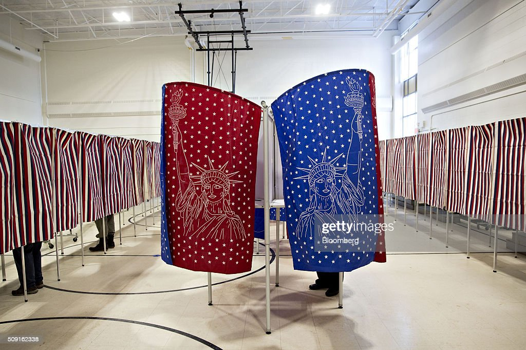 Voters stand in voting booths in a polling place in Manchester, New Hampshire, U.S., on Tuesday, Feb. 9, 2016. Voters in New Hampshire took to the polls today in the nations first primary in the U.S. presidential race. Photographer: Daniel Acker/Bloomberg via Getty Images