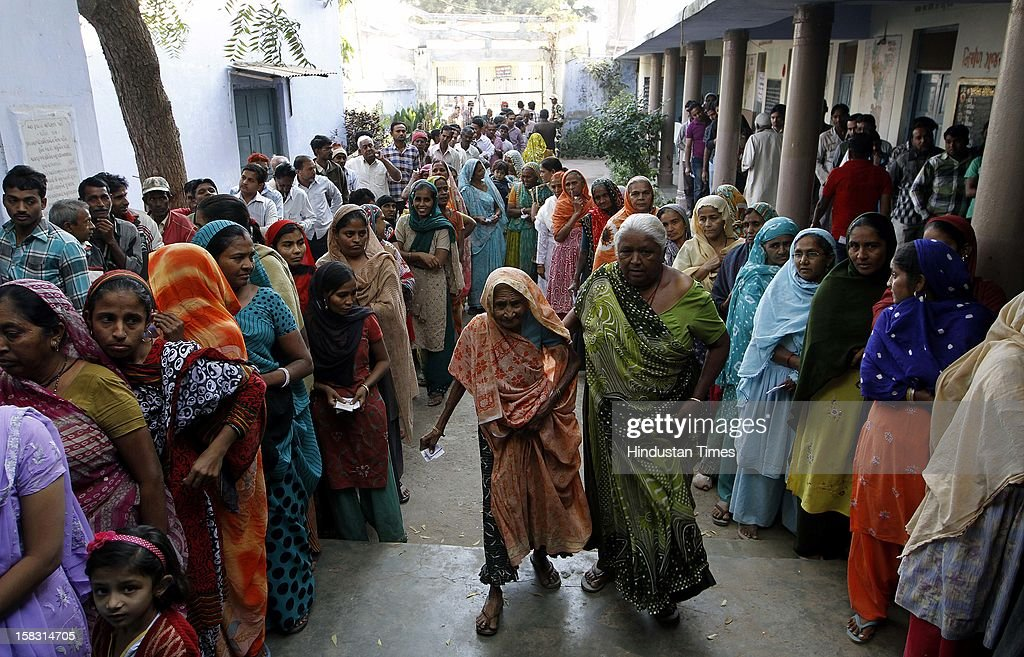Voters standing in queue during the first phase polling of Gujarat assembly election at Dholka on December 13, 2012 in Ahmedabad, India.