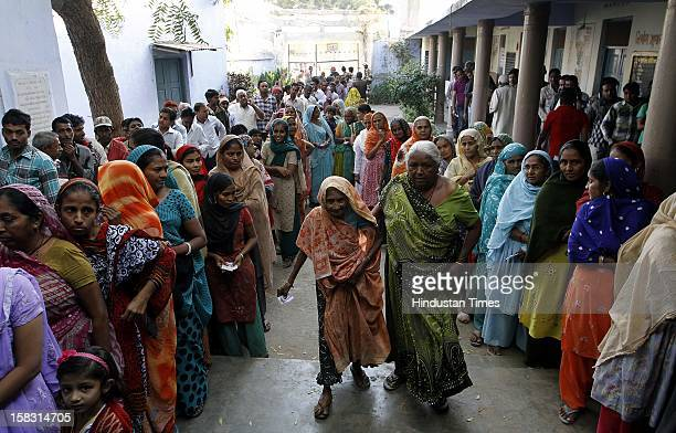 Voters standing in queue during the first phase polling of Gujarat assembly election at Dholka on December 13 2012 in Ahmedabad India