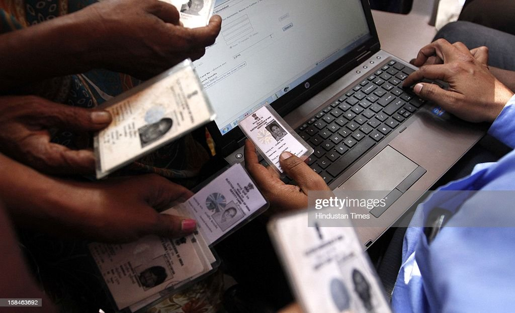 Voters trying to locate their polling booth as they couldn't find name in the voters list during the last phase assembly poll at Ahmedabad on December 17, 2012 in Gujarat, India.