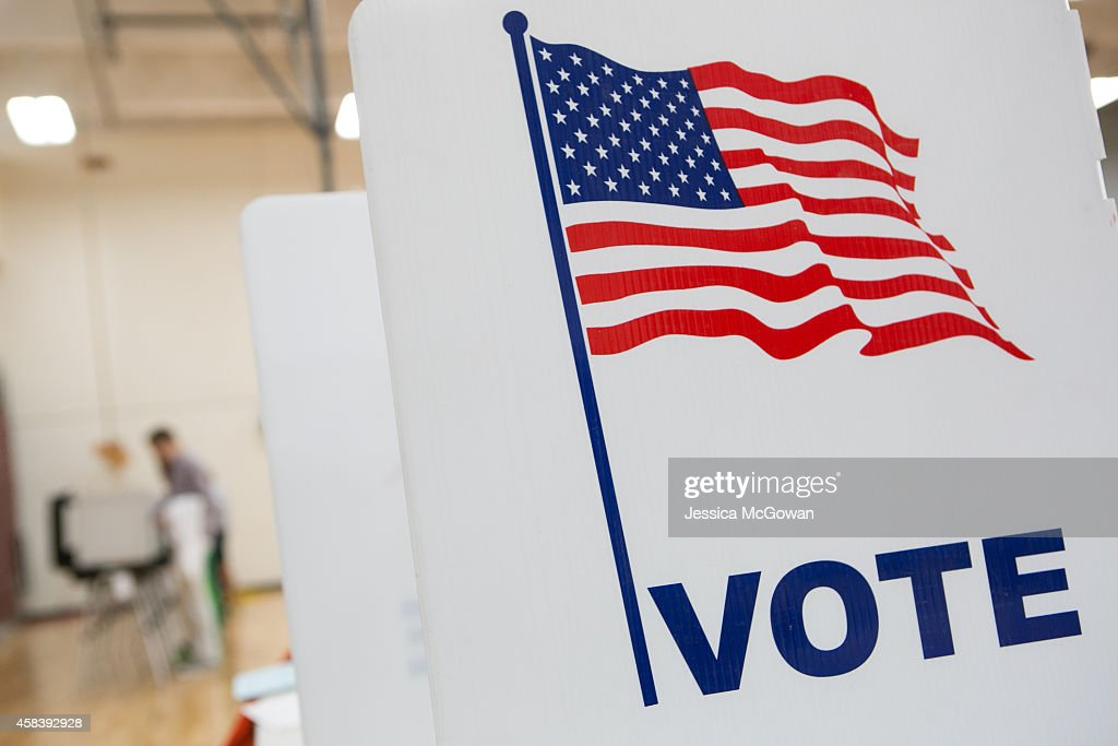 Voters turn out to cast their ballots for the midterm election at Grady High School on November 4 2014 in Atlanta Georgia Georgia Democratic US...