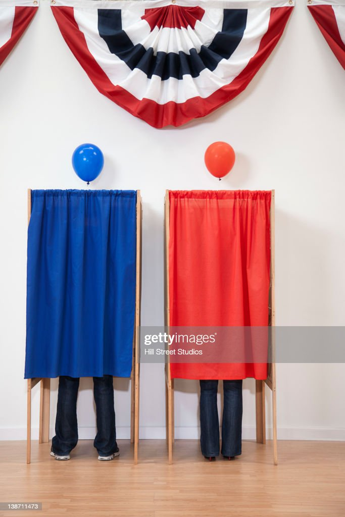 Voters voting in polling place : Stock Photo