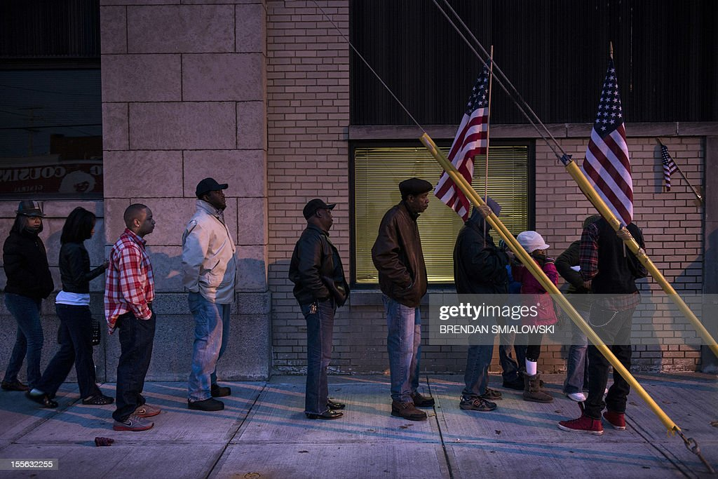 Voters wait in front of the Mt Pleasant Library November 6 2012 in Cleveland Ohio Citizens around the United States head to the polls to vote on the...