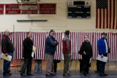 Voters wait in line at the Memorial High School polling station in Manchester New Hampshire US on Tuesday Nov 6 2012 US President Obama is seeking to...