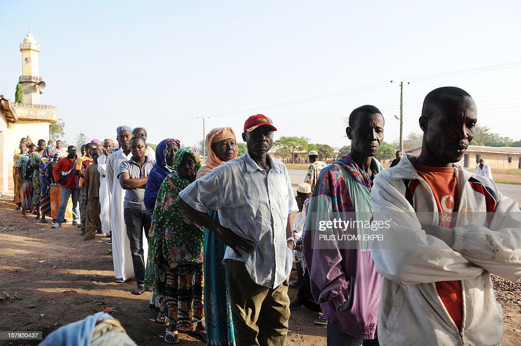Voters wait in line near a mosque before casting their ballot at the Bole polling station, in the Bole Bamboi constituency of northern Ghana, on December 7, 2012, during the national elections. Ghana voted in a high-stakes presidential election today which is expected to be close, with the emerging country seeking to live up to its promise as a beacon of democracy in turbulent West Africa.