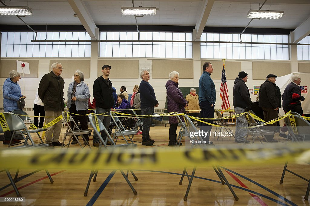 Voters wait in line to cast ballots at a polling station inside Broken Gound Elementary School in Concord, New Hampshire, U.S., on Tuesday, Feb. 9, 2016. Voters in New Hampshire took to the polls today in the nation's first primary in the U.S. presidential race. Photographer: Victor J. Blue/Bloomberg via Getty Images
