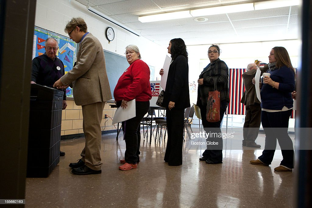 Voters wait in line to cast their ballots at St. Pius CCD Center in Manchester, New Hampshire on Election Day, November 6, 2012.