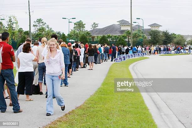 Voters wait in line to cast their ballots in the US presidential election at a polling station in Orlando Florida US on Tuesday Nov 4 2008 Long lines...