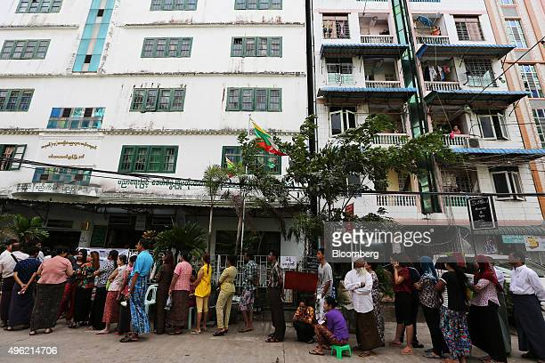 Voters wait in line to cast their vote outside a polling station during a general election in Yangon Myanmar on Sunday Nov 8 2015 Nobel laureate Aung...