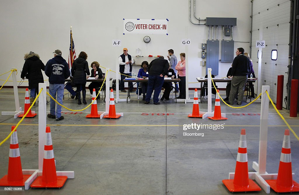 Voters wait in line to check in at a polling station inside the Newmarket Fire Department in Newmarket, New Hampshire, U.S., on Tuesday, Feb. 9, 2016. Voters in New Hampshire took to the polls today in the nation's first primary in the U.S. presidential race. Photographer: Luke Sharrett/Bloomberg via Getty Images