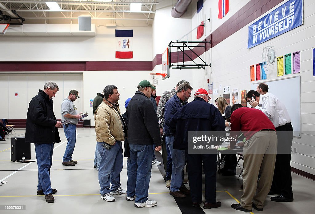 Voters wait in line to register at the Ankeny 9 Republican caucus on January 3 2012 in Ankeny Iowa Iowans are preparing to caucus to vote for their...