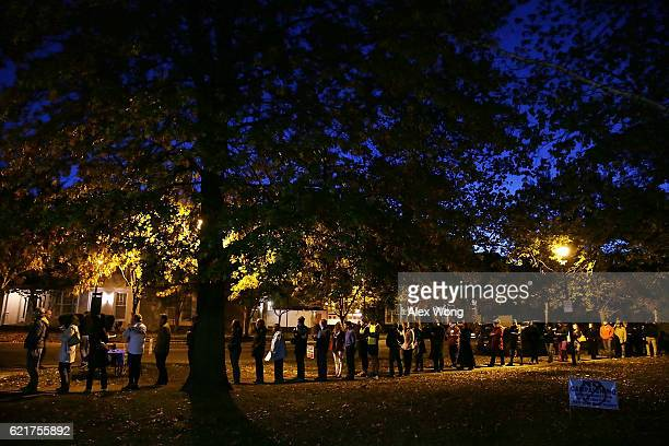 Voters wait inline for casting their ballots outside a polling place on Election Day November 8 2016 in Alexandria Virginia Americans across the...