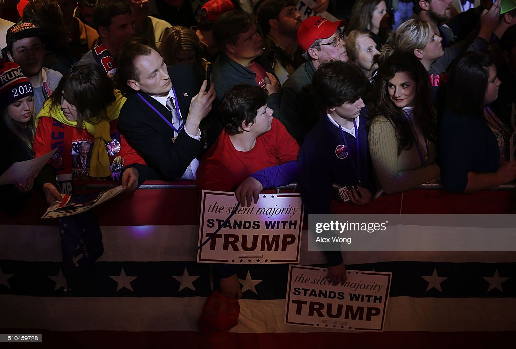 Voters wait to greet Republican presidential candidate Donald Trump during a campaign event February 15 2016 in Greenville South Carolina Trump...