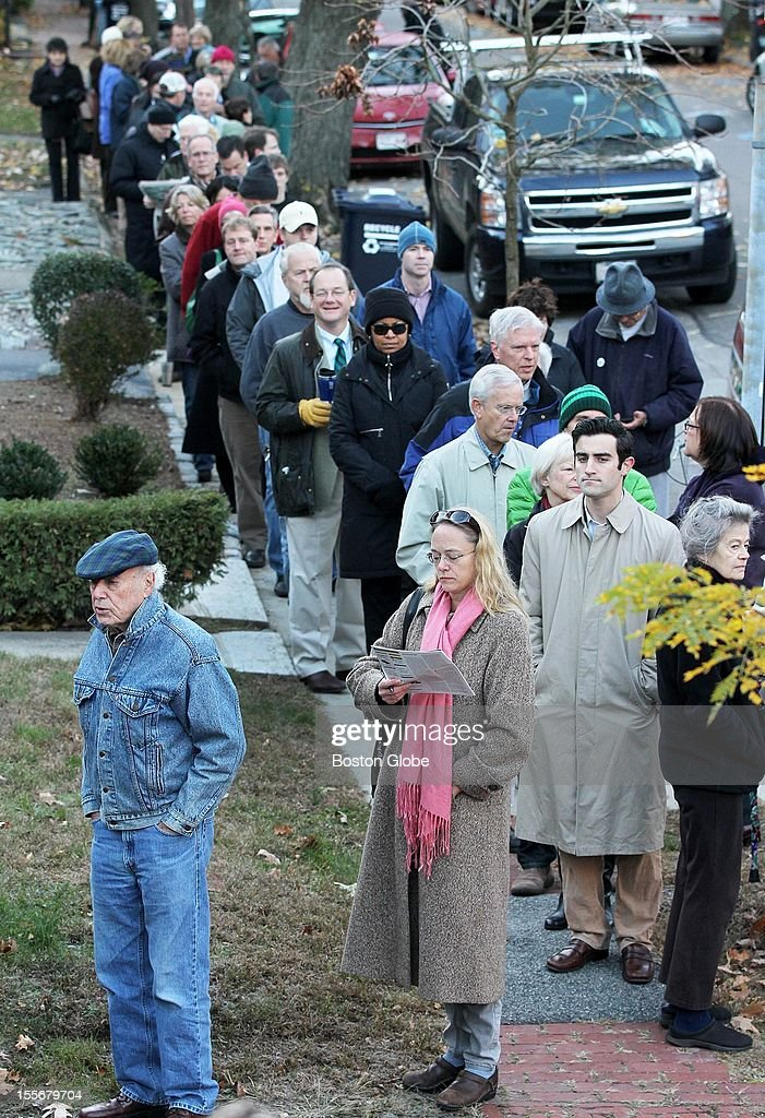 Voters waited for the polls to open outside a fire station on Lexington Avenue in Cambridge, Mass., on Election Day, Tuesday, November 6, 2012.