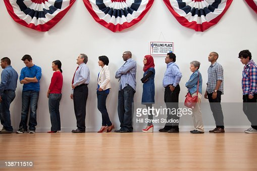 Voters waiting to vote in polling place : Stock Photo