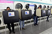 Voters work on their ballots at their polling place Su Nueva Laundromat on November 4 2014 in Chicago Illinois Illinois voters are selecting a...