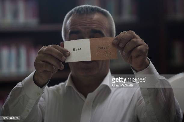 Votes are counted and shown to observers at a voting station on April 16 2017 in Istanbul Turkey Constitutional referendum voting opened across...