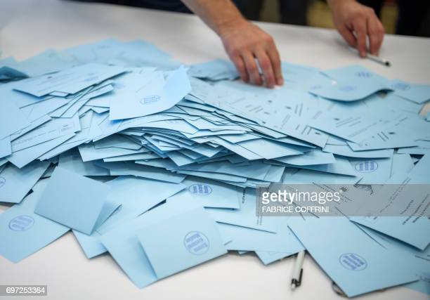 Votes are counted during an election on the cantonal membership of the commune of Moutier on June 18 2017 in Moutier northern Switzerland Moutier...