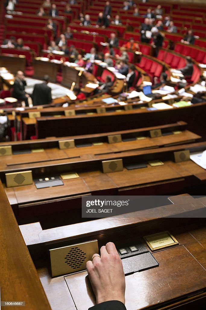 A MP votes during the debate to allow gay couples to get married and adopt children on February 4, 2013 at the National Assembly in Paris. Two days before, Members of Parliament voted 249-97 in favour of Article One of the draft law, which redefines marriage as being a contract between two people rather than necessarily between a man and a woman.