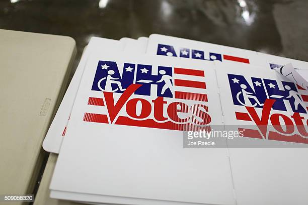 Votes signs are seen at the Newmarket Fire and Rescue station in preparation for tomorrow's primary voters on February 8 2016 in Newmarket New...