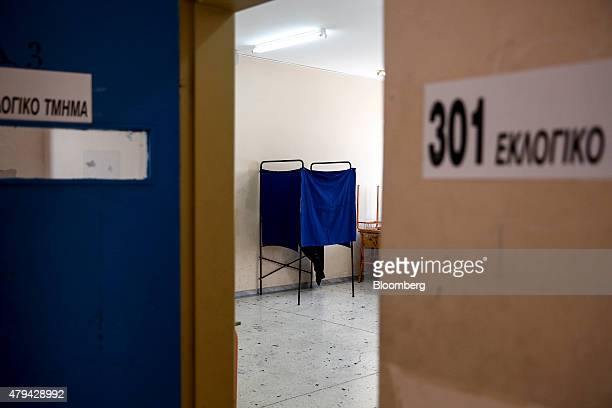 A voting booth seen through a doorway stands at a voting station inside a school classroom in Athens Greece on Saturday July 4 2015 Greek and...