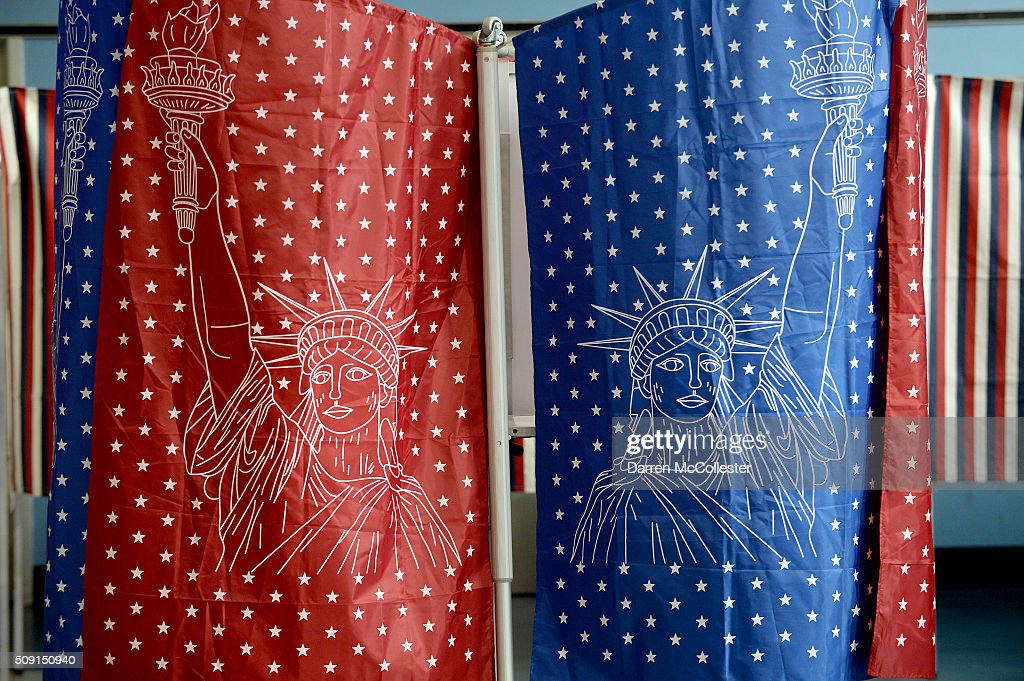 Voting booths are seen as voters cast their ballots at the Bishop Leo E. O'Neil Youth Center February 9, 2016 in Manchester, New Hampshire. New Hampshire voters finally go to the polls in the first in the nation primary state that begins the long election season.
