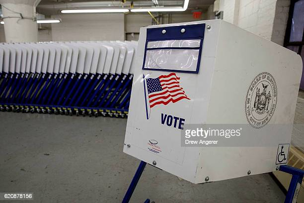 Voting booths sit at a New York City Board of Elections voting machine facility warehouse November 3 2016 in the Bronx borough in New York City The...