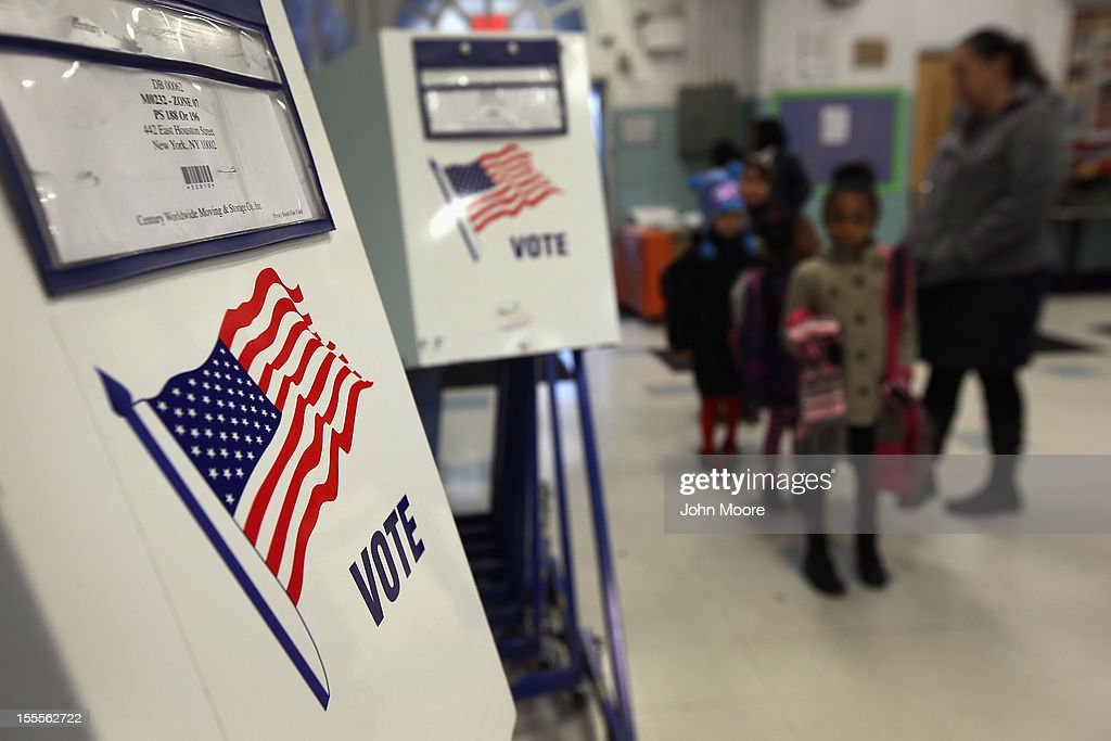 Voting booths stand at the ready as students return to school on November 5 2012 in the East Village neighborhood of New York United States Students...