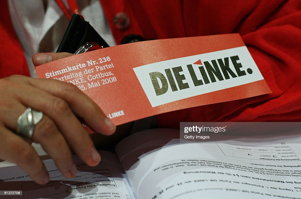 A voting card is seen in the hand of a delegate at the party convention of the German leftwingparty Die Linke on May 24 2008 in Cottbus Germany It is...