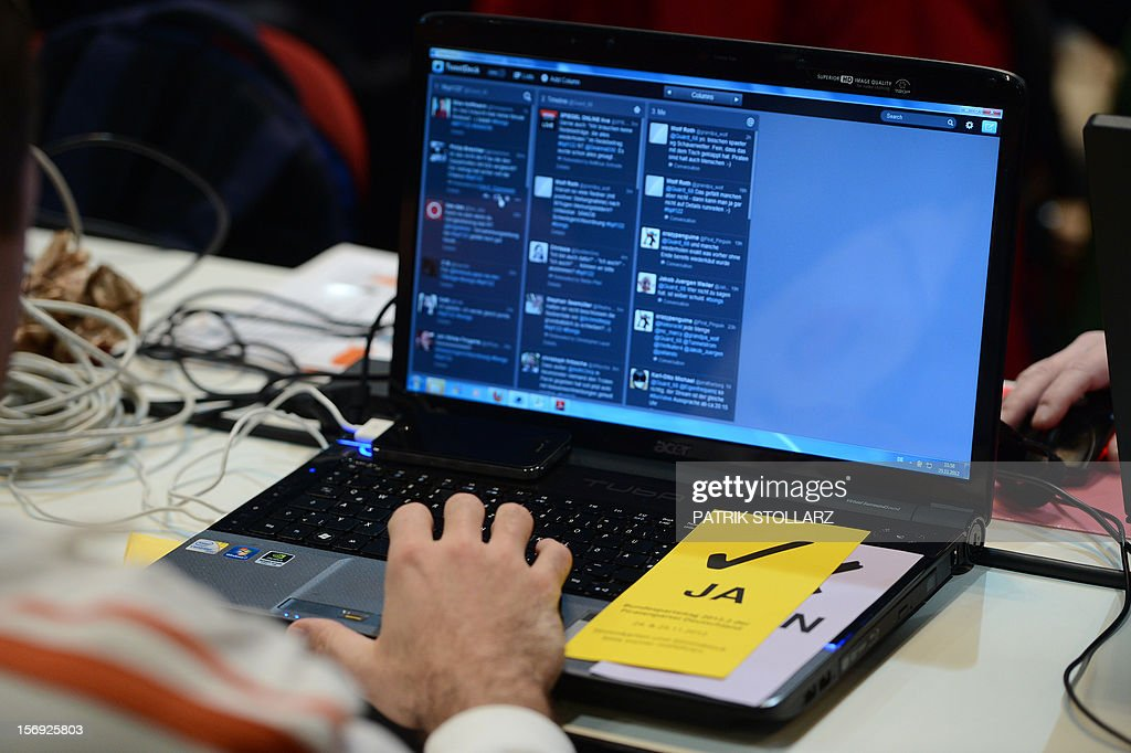 A voting card lies on a laptop at a party congress of the Pirates party in Bochum, western Germany, on November 25, 2012. The Pirate Party is meeting for two days to prepare a party platform for the 2013 general elections. AFP PHOTO / PATRIK STOLLARZ
