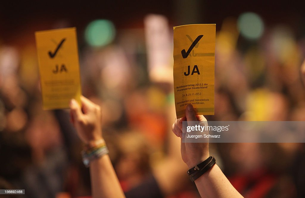 Voting cards are lifted at the federal party convention of the German Pirates Party (Die Piratenpartei) on November 24, 2012 in Bochum, Germany. The Pirates, after riding an initial surge in popularity last year that landed them seats in several German state parliaments, have since seen their popularity erode as recent scandals and infighting have tarnished the party's image. Germany faces federal elections in 2013.