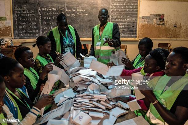 TOPSHOT Voting officals count ballots on August 8 2017 at the Victoria primary school polling station in Kisumu Victoria primary school is one of the...