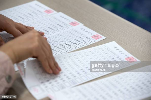 Voting papers sit on a table at a polling station in Seoul South Korea on Tuesday May 9 2017 South Koreans began voting Tuesday in a special election...