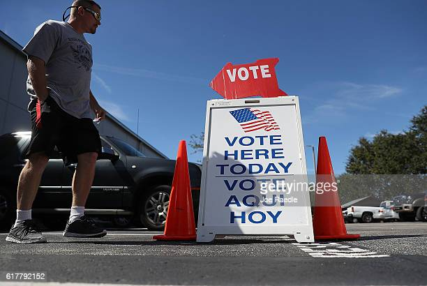 A voting sign points early voters to the polling station at the Hillsbourgh County Supervisor of Elections office on October 24 2016 in St Petersburg...