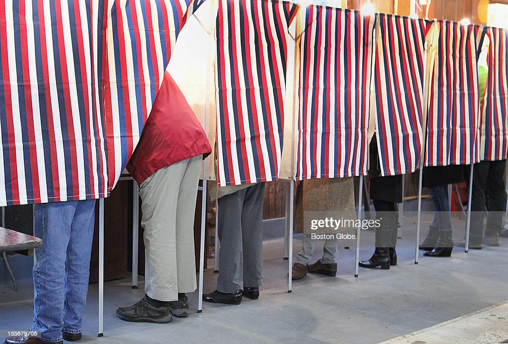 Voting was brisk as the polls opened at a fire station on Lexington Avenue in Cambridge on Election Day, Tuesday, November 6, 2012.