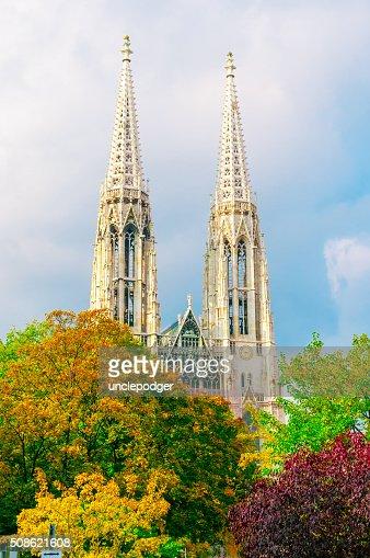 Votive Church (Votivkirche) and autumn trees in Vienna, Austria : Stock Photo