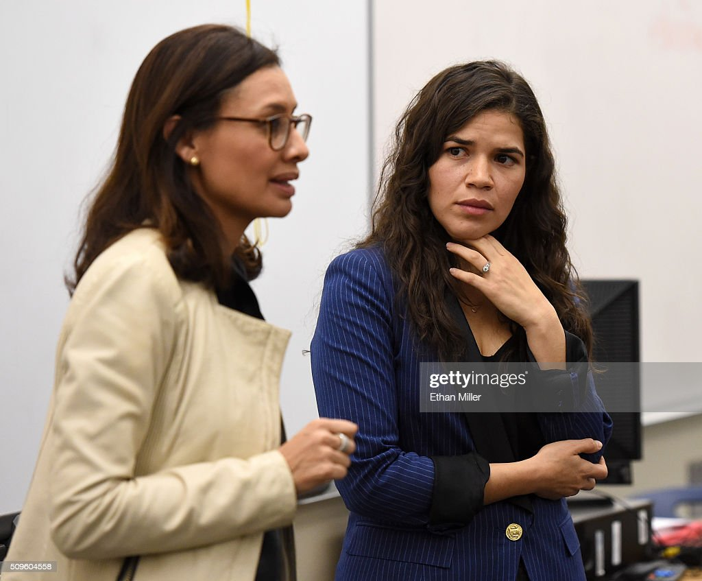 Voto Latino President and CEO Maria Teresa Kumar (L) and actress <a gi-track='captionPersonalityLinkClicked' href=/galleries/search?phrase=America+Ferrera&family=editorial&specificpeople=216393 ng-click='$event.stopPropagation()'>America Ferrera</a> talk to students at Rancho High School to discuss the importance of young voters, including Latinos, participating in the civic process on February 11, 2016 in North Las Vegas, Nevada. Nevada's caucus for the Democratic presidential candidate is on February 20 and the Republicans caucus on February 23.