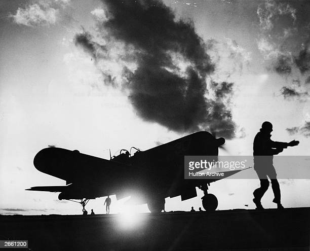 A Vought F4U2 Corsair fighter takes off from the deck of the aircraft carrier the SS Leyte