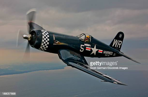 A Vought F4U-5 Corsair in VMF-312 markings during the Korean War, flying over Oshkosh, Wisconsin.