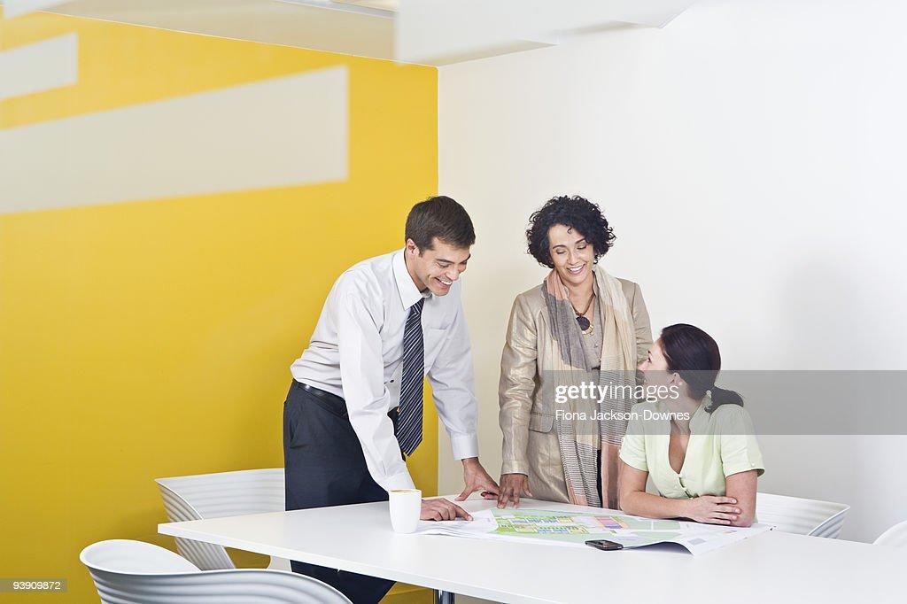 A voyeuristic shot of a meeting : Stock Photo