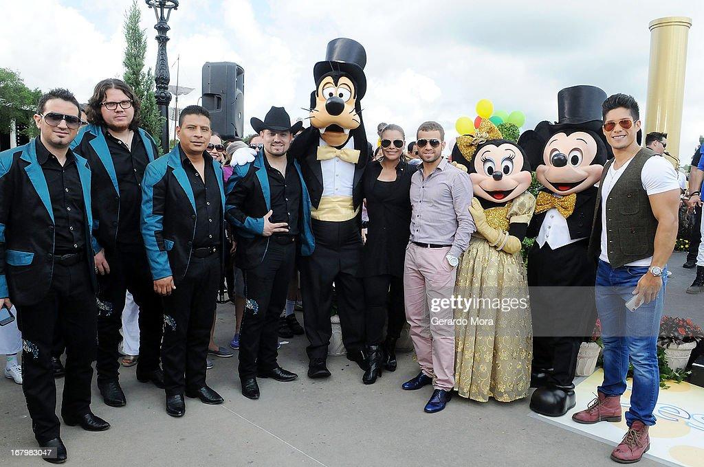 Voz de Mando, Olga Tanon, Nacho, and Chino pose during Univision's morning show Despierta America 16th anniversary at Epcot Center Walt Disney World on May 3, 2013 in Orlando, Florida.