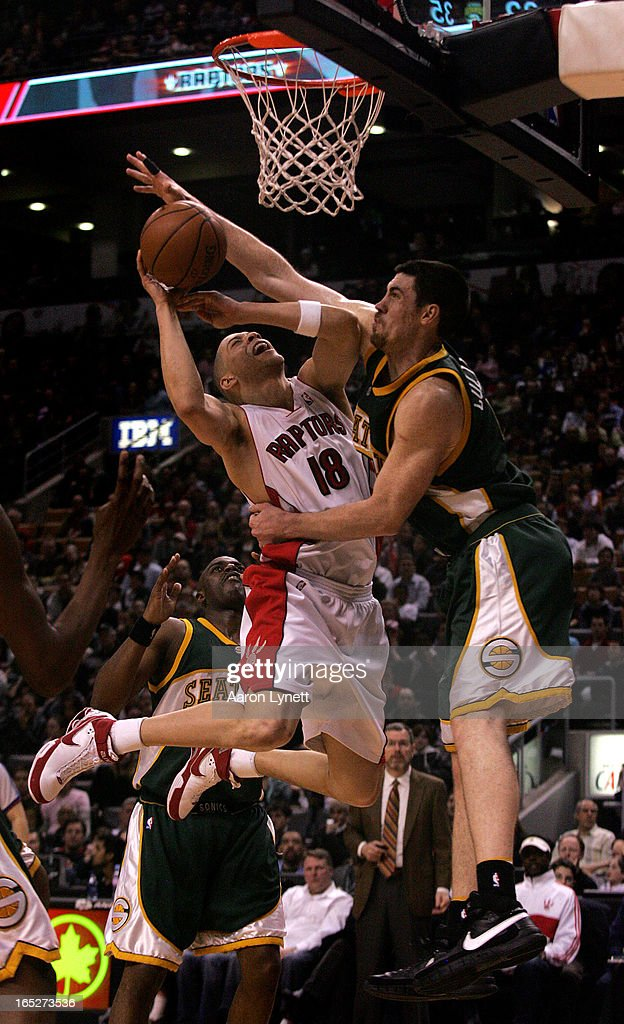 RAPTORS vs SUPERSONICS.. Toronto Raptors guard Anthony Parker is fouled hard by Seattle SuperSonics forward Nick Collison (right) as teammate Damien Wilkins looks on in the second half as the Toronto Raptors take on the Seattle Supersonics, Sunday afternoon, March 9, 2008 at Air Canada Centre.The Raptors defeated the Supersonics 114-106. (Aaron Lynett/Toronto Star)ajl