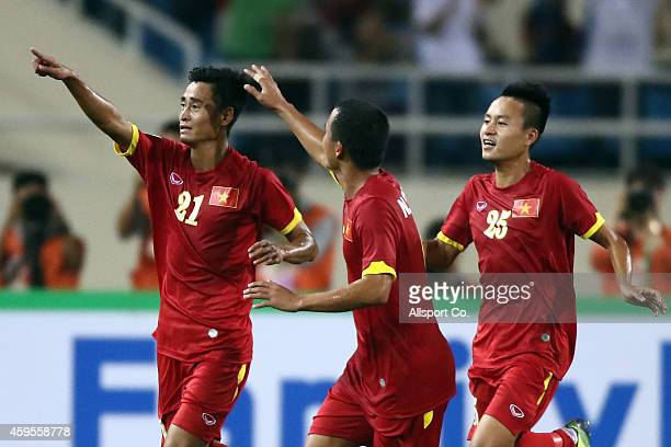 Vu Minh Tuan#21 of Vietnam celebrates after scoring against Laos during the 2014 AFF Suzuki Cup Group A match between Laos and Vietnam at the My Dinh...